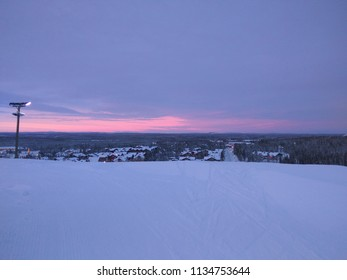Lapland Winter landscape with sunset. Colorful pink and purple sky during sunset in Lapland, Finland