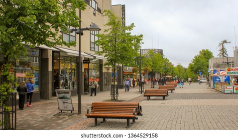 Lappeenranta, Finland. 12.06.2012. Benches on the pavement in the city