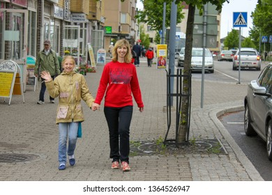 Lappeenranta, Finland. 12.06.2012. Mother and daughter are on the sidewalk of the city