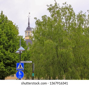 Lappeenranta, Finland. 12.06.2012. Road sign on the background of the Park and towers
