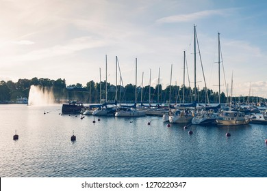 LAPPEENRANTA, FINLAND - AUGUST 8, 2017: Boats at pier at Lappeenranta harbour, old fort at the back