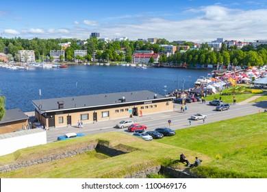 Lappeenranta , Finland - July 1, 2017: Landscape of Lappeenranta harbor in summer day, ordinary people walk on coastal road