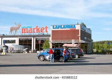 LAPPEENRANTA, FINLAND - JUNE 15, 2016: Laplandia Market near Finnish-Russian border. People put purchases into the car