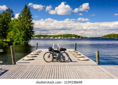 Lappeenranta, Finland - June 23, 2018: The picturesque nature of Finland. Saimaa lake, a beautiful summer view of with the bike on a wooden platform