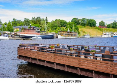 Lappeenranta, Finland - June 24, 2018: open street cafe on the shore of lake Saimaa in the center of Lappeenranta