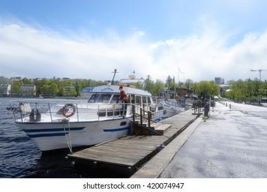 LAPPEENRANTA, FINLAND - MAY 11, 2016: Lappeenranta harbor on the Saimaa lake at spring after the rain, Finland. Lappeenranta - city and municipality in Finland, in the province of Eastern Finland.