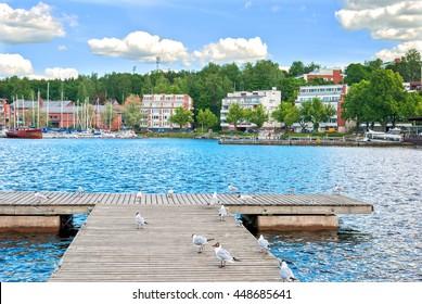 Lappeenranta. Fonland. Small wooden pier with seagulls on The Saimaa Lake