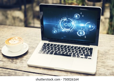 Laptop with abstract ICO interface on screen. Bitcoin concept