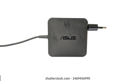 Laptop AC adapter charger isolated on white background (Asus AC adapter). Indonesia - August 3, 2019