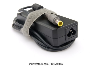 Laptop AC adapter on white