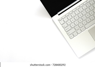 Laptop with black screen on white background with copy space.