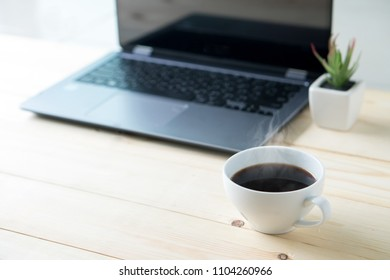 Laptop with blank screen on table interior