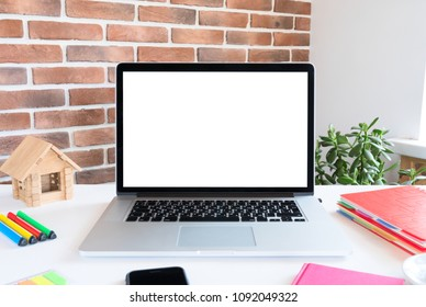 Laptop with blank screen on the workplace.