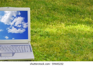 laptop and blue sky showing nature concept with copyspace