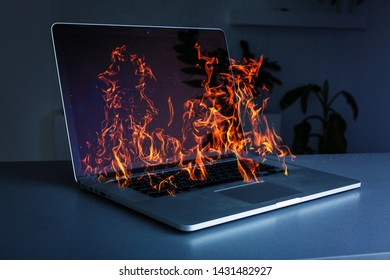 Laptop burning with fire on background