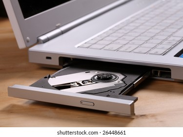 Laptop with cd / DVD tray open ready for work