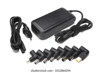 Laptop charger with different adapters on white background