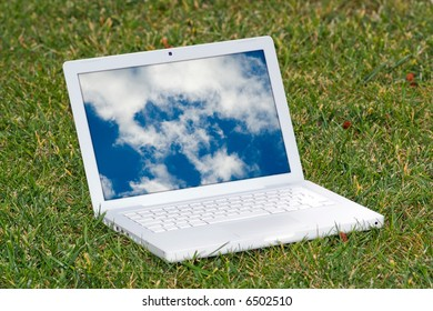 Laptop with clouds on the grass