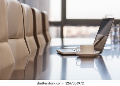 Laptop and coffee in the conference room