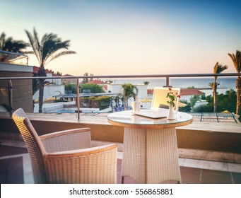 A laptop and a coffee cup on  table on beautiful sea background. Business, freelancer, vacation concept