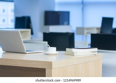 Laptop and coffee inside a modern style company