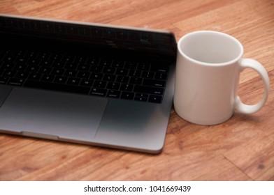Laptop with Coffee mug