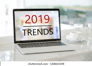 Laptop computer with 2019 trends on screen background, digital marketing, business and technology concept