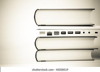 laptop computer between books