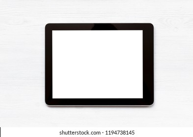 Laptop computer with blank screen on the white office table background.