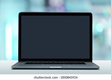 Laptop computer with a blank screen on the desk