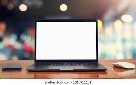 laptop computer blank white screen and mobile on table in cafe background