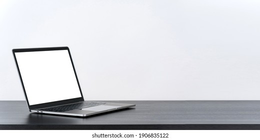 Laptop computer blank white screen on table on white background