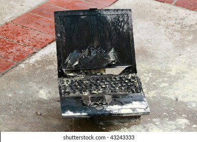 Laptop computer burned in a fire, represents computer damage, loss of data, emergency and more
