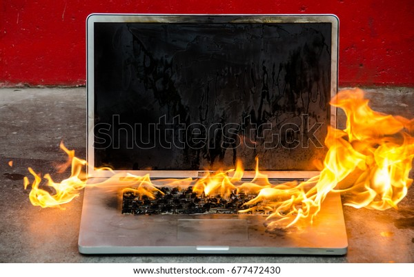 Laptop computer bursting into flames and burning intensely