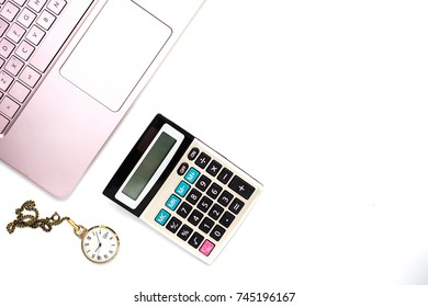 Laptop computer and calculatort on white office desk with gold pen and clock on white background