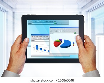 laptop with computer graphics on screen in hands