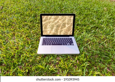 Laptop computer in nature - freelance or remote work concept