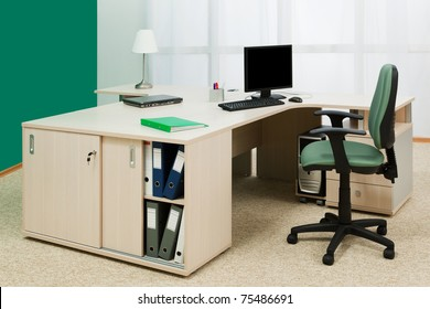 laptop and computer on a desk in a modern office