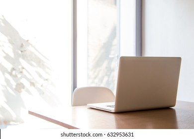 Laptop computer on office desk