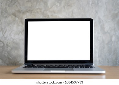 laptop computer on work desk with blank screen