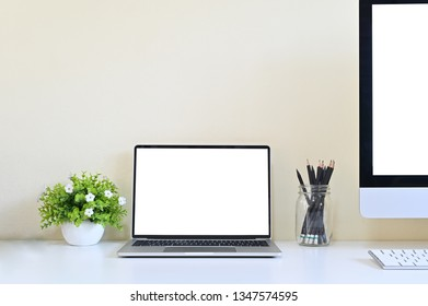 Laptop computer and PC on office desk, Workspace with mockup.
