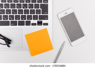 laptop computer and post its