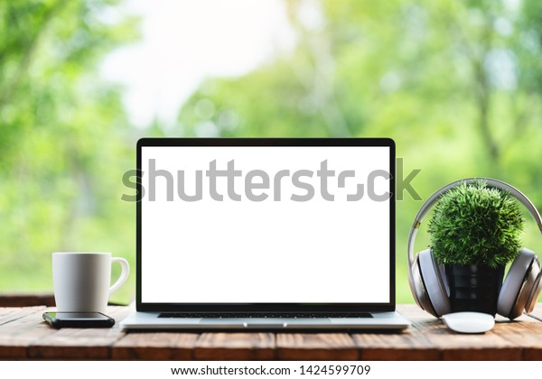 laptop computer showing white frame morning nature background