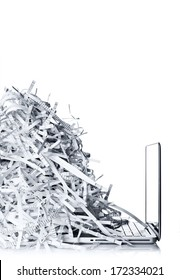 Laptop computer and shredded paper