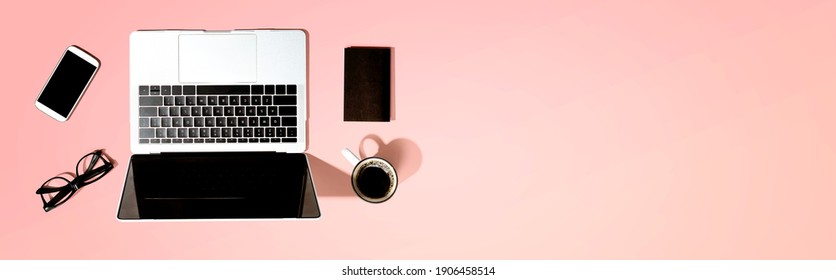 Laptop computer with a smartphone and office objects
