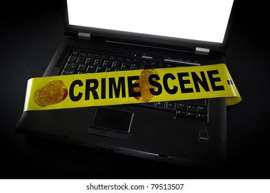 laptop with crime scene tape across it and fingerprints