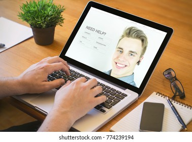 laptop customer serviceconcept. Close-up top view of man with customer support website on laptop. all screen graphics are made up.