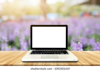 Laptop Empty top wooden table and blur with bokeh background. For product display