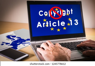 Laptop with eu flag, copyright and Article 13 words on screen. Symbolizing the EU Directive on Copyright in the Digital Single Market or CDSM. Art. 13 is known as meme ban