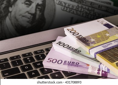 Laptop with a lot of euros